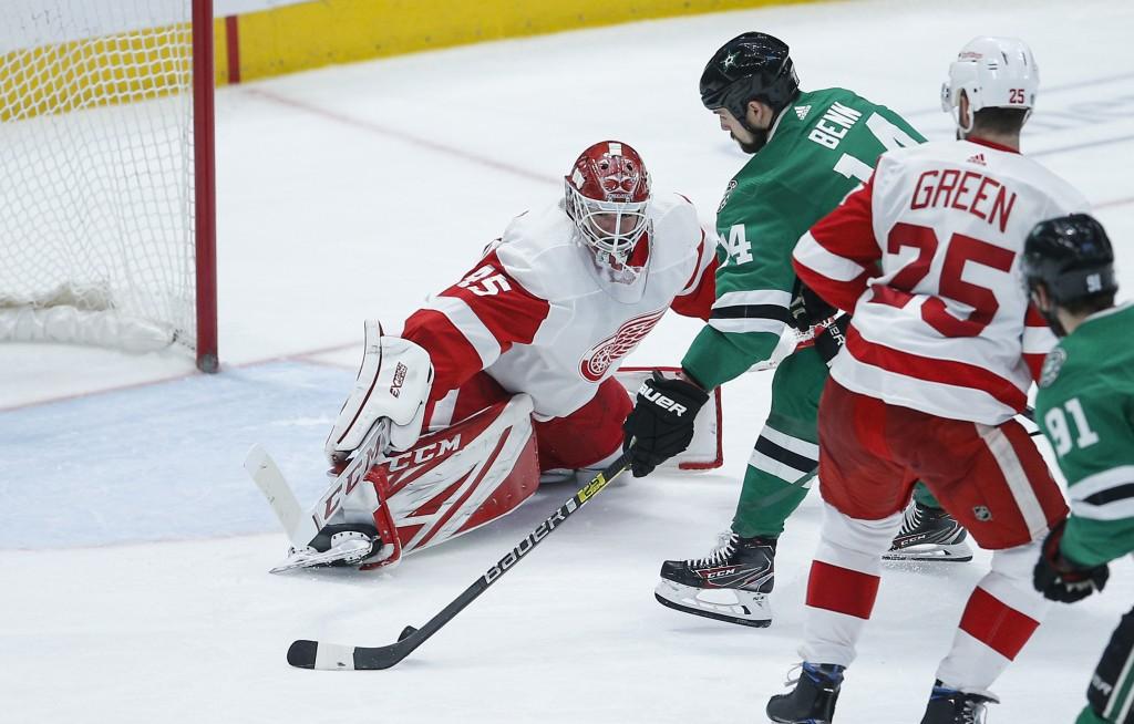 Dallas Stars forward Jamie Benn (14) attempts a shot as Detroit Red Wings goaltender Jonathan Bernier (45) defends during the third period of an NHL h...