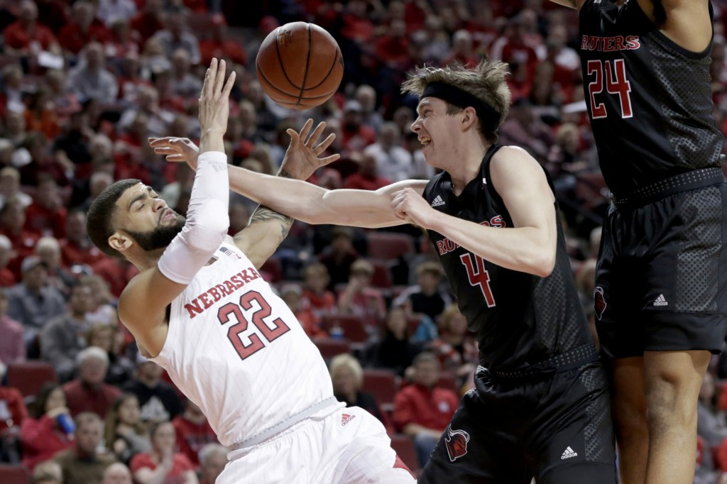 Nebraska's Haanif Cheatham (22) is fouled by Rutgers' Paul Mulcahy (4) during the first half of an NCAA college basketball game in Lincoln, Neb., Frid...