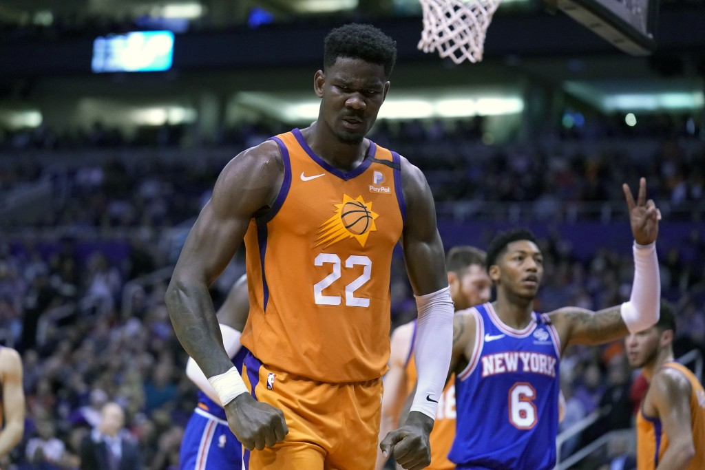 Phoenix Suns center Deandre Ayton (22) reacts after blocking a shot by New York Knicks forward Julius Randle in the first half during an NBA basketbal...