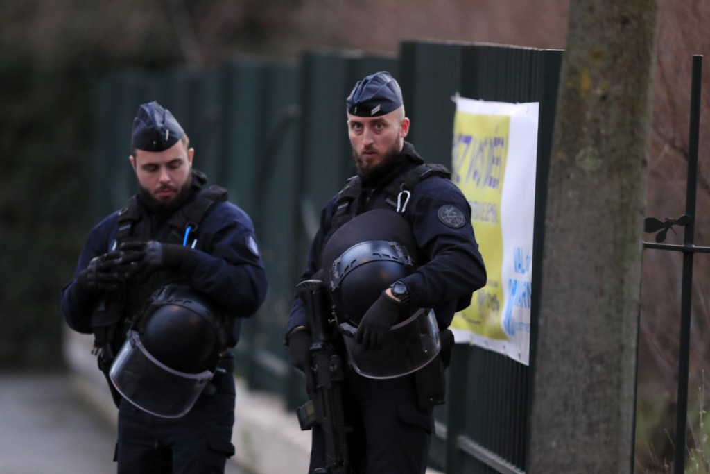 Riot police officers look on after a man attacked passerby Friday Jan.3, 2020 in Villejuif, south of Paris. A man armed with a knife rampaged through ...