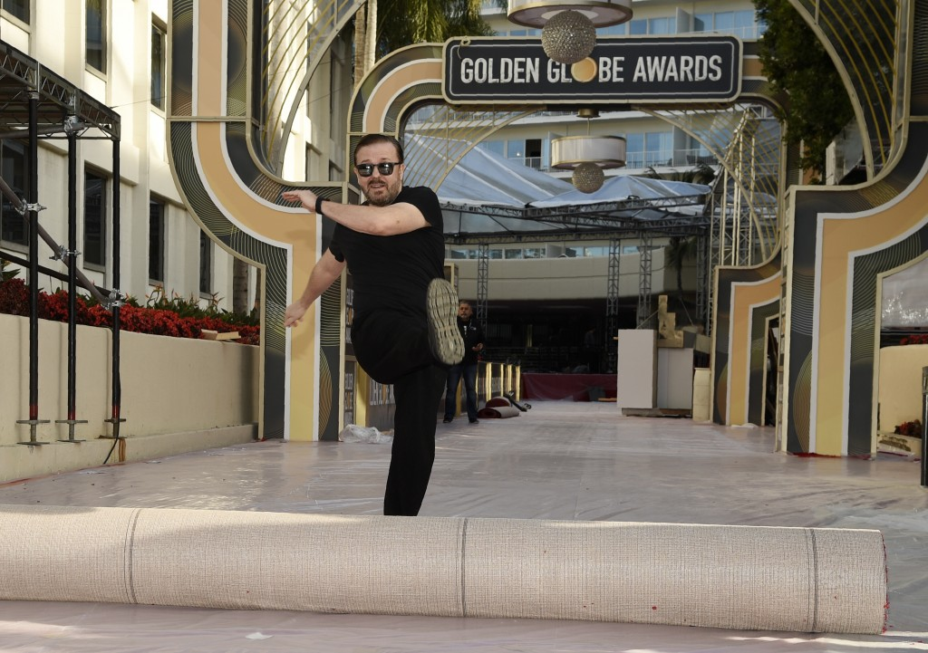 Ricky Gervais, host of this Sunday's 77th annual Golden Globe Awards, kicks out the red carpet during Preview Day for the Globes at the Beverly Hilton...