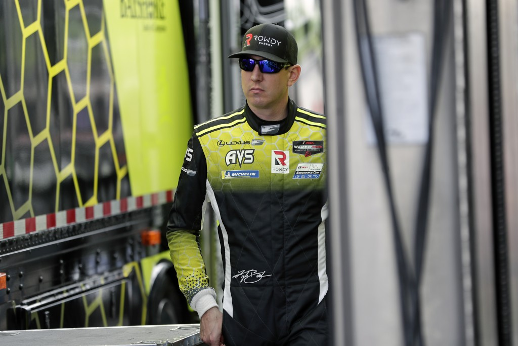 Kyle Busch heads to his garage during testing for the upcoming Rolex 24 hour auto race at Daytona International Speedway, Friday, Jan. 3, 2020, in Day...