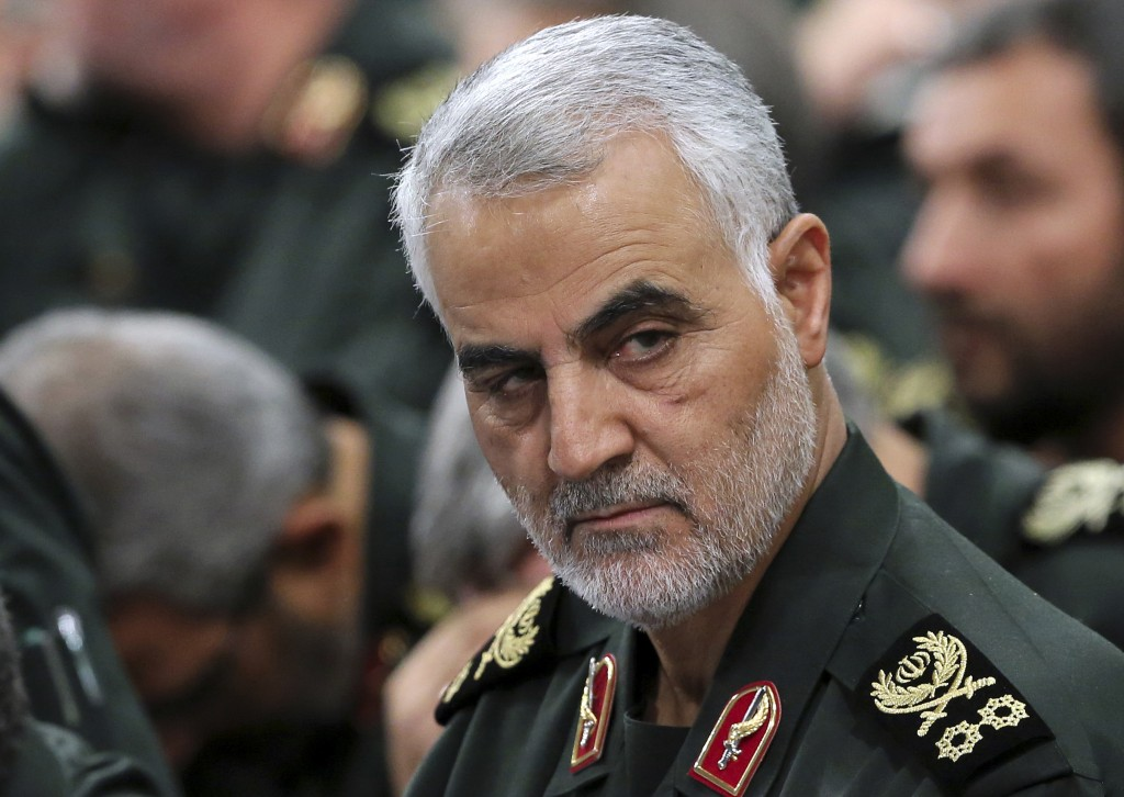FILE- In this Sept. 18, 2016 photo released by an official website of the office of the Iranian supreme leader, Revolutionary Guard Gen. Qassem Soleim...