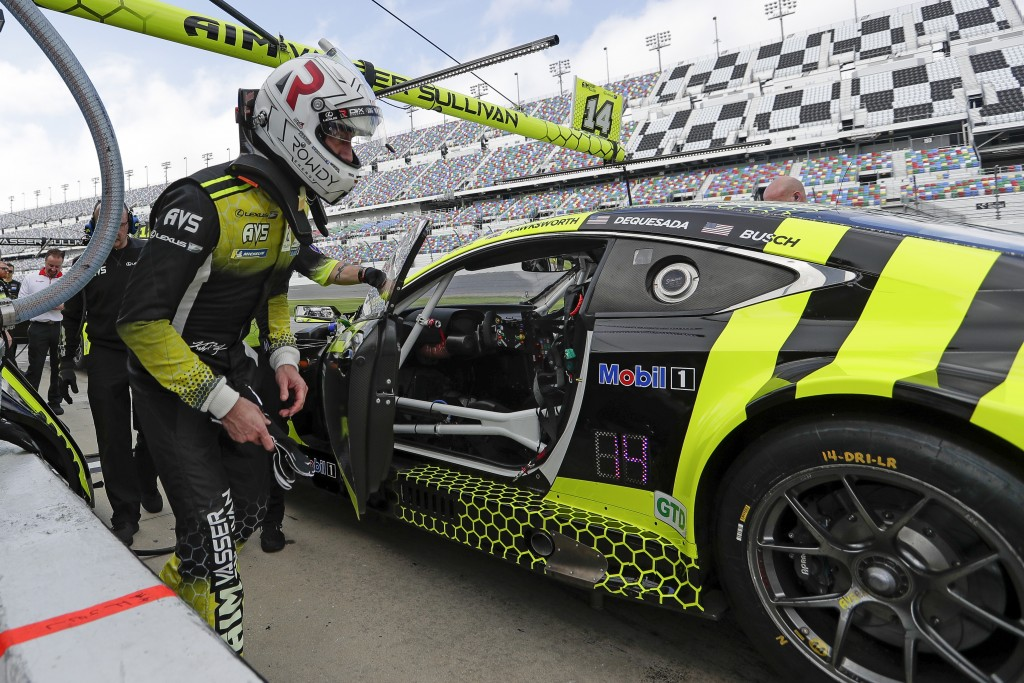 Kyle Busch climbs in his car for a turn to drive during testing for the upcoming Rolex 24 hour auto race at Daytona International Speedway, Friday, Ja...
