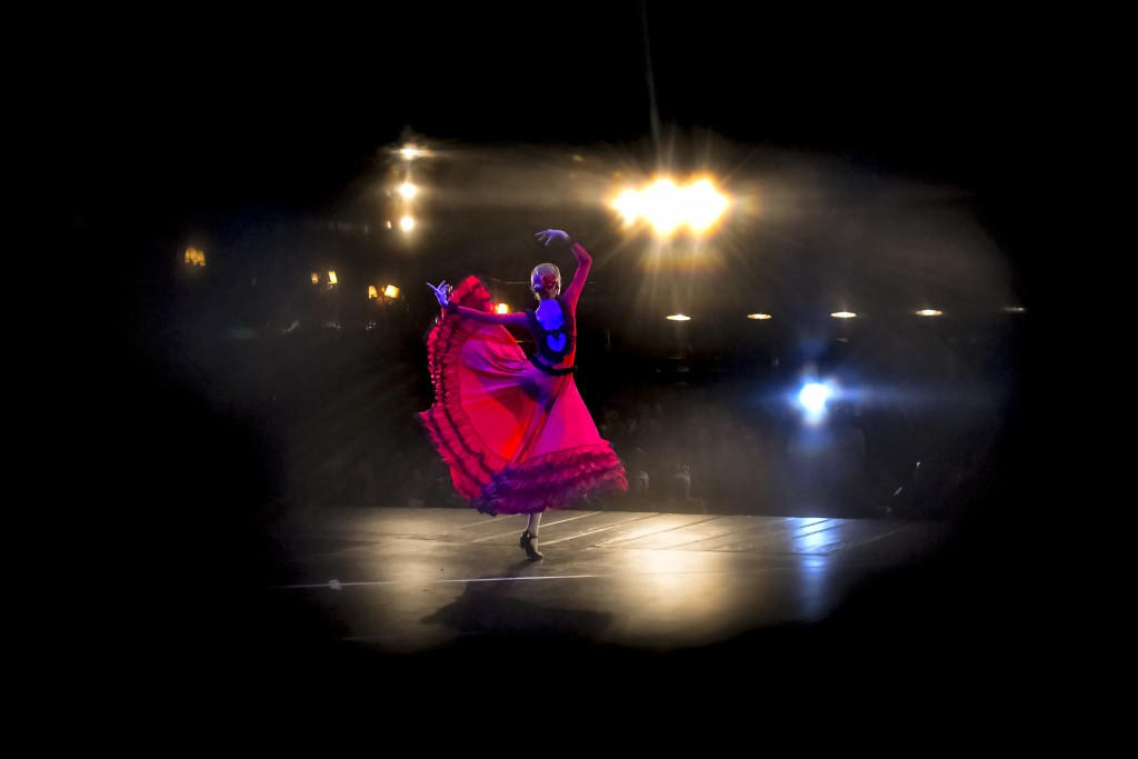 In this Nov. 3, 2019, photograph a ballerina of the Arabesque Children's Ballet Ensemble, seen through a hole in the stage curtains performs during a ...