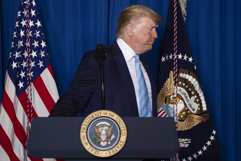 President Donald Trump walks off after delivering remarks on Iran, at his Mar-a-Lago property, Friday, Jan. 3, 2020, in Palm Beach, Fla. (AP Photo/ Ev...