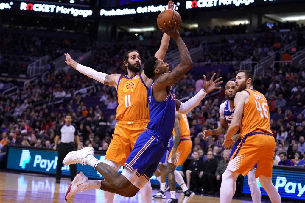 New York Knicks guard Elfrid Payton, front left, drives past Phoenix Suns guard Ricky Rubio (11) in the first half of an NBA basketball game, Friday, ...