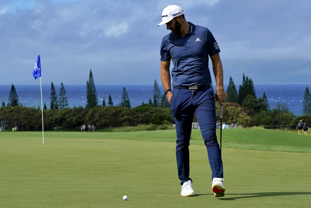 Dustin Johnson looks at his ball on the third green during second round of the Tournament of Champions golf event, Friday, Jan. 3, 2020, at Kapalua Pl...