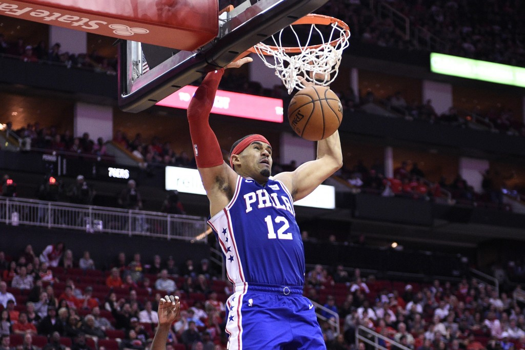 Philadelphia 76ers forward Tobias Harris dunks during the second half of the team's NBA basketball game against the Houston Rockets, Friday, Jan. 3, 2...