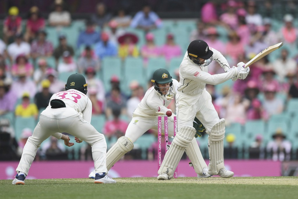 New Zealand batsman Tom Blundell is bowled by Australia's Nathan Lyon next to Australia's Tim Paine during play on day three of the third cricket test...