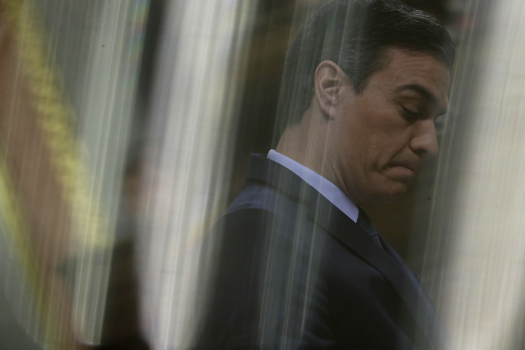Spain's interim Prime Minister Pedro Sanchez pauses while addressing the Spanish Parliament in Madrid, Spain, Sunday, Jan. 5, 2020. Sanchez is facing ...