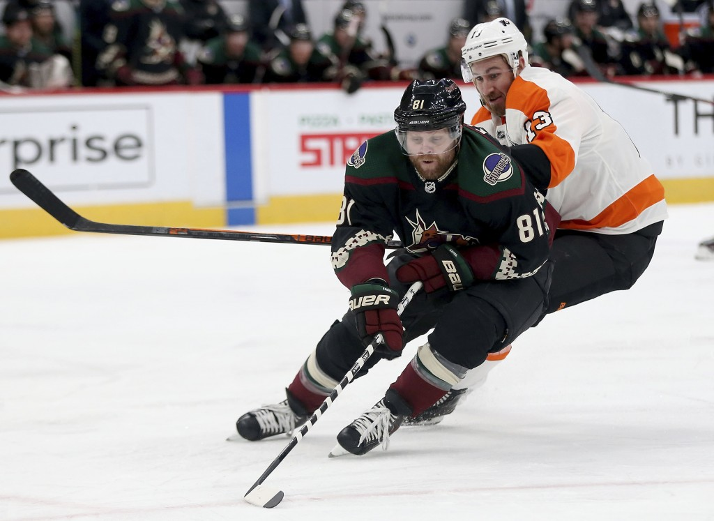Arizona Coyotes' Phil Kessel controls the puck against Philadelphia Flyers' Kevin Hayes (13) during the first period of an NHL hockey game Saturday, J...