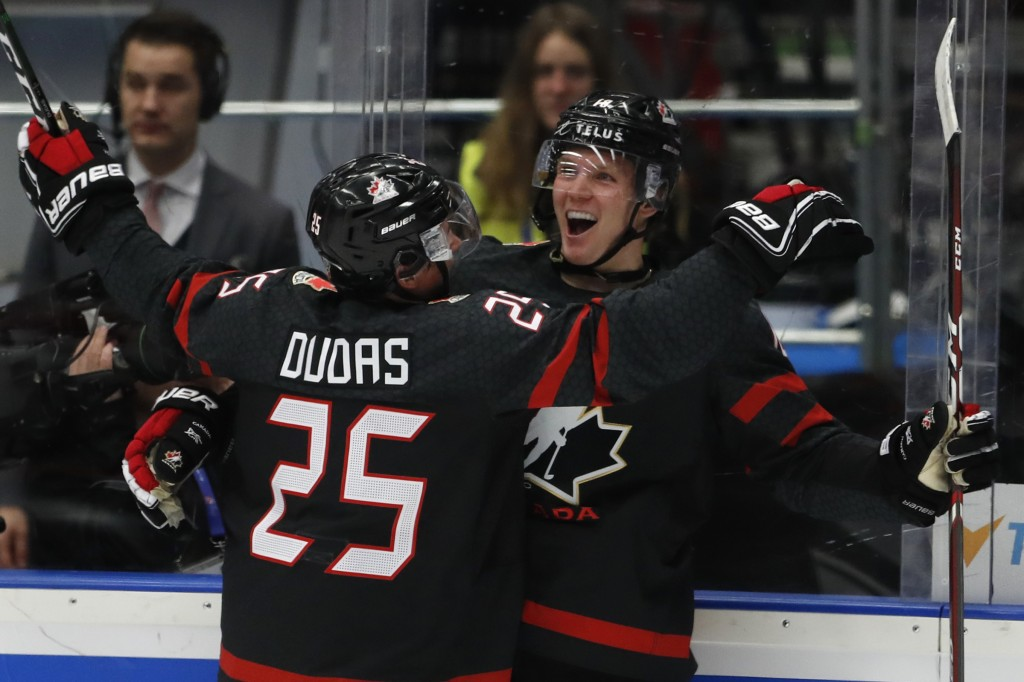 Canada's Ty Dellandrea, right, celebrates with Canada's Aidan Dudas, left, after scoring his sides fourth goal during the U20 Ice Hockey Worlds semifi...