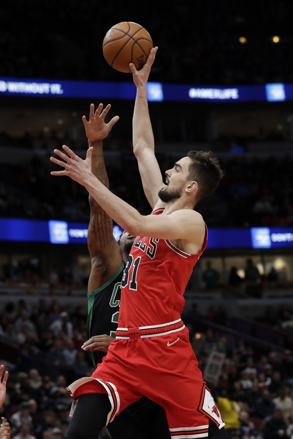 Chicago Bulls guard Tomas Satoransky, right, drives to the basket against Boston Celtics guard Marcus Smart during the first half of an NBA basketball...