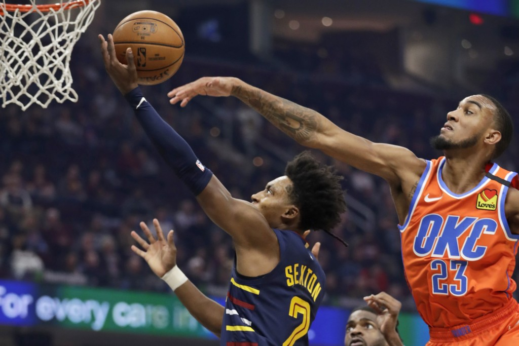 Cleveland Cavaliers' Collin Sexton (2) drives to the basket against Oklahoma City Thunder's Terrance Ferguson (23) in the first half of an NBA basketb...