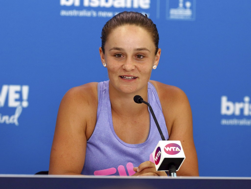 Ashleigh Barty of Australia talks to the media during a press conference ahead of the Brisbane International tennis tournament in Brisbane, Australia,...