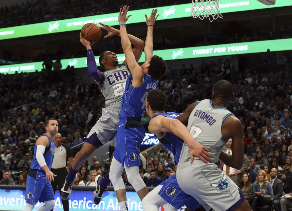 Charlotte Hornets forward PJ Washington (25) goes up to shoot against Dallas Mavericks forward Justin Jackson (44) in the first half in an NBA basketb...