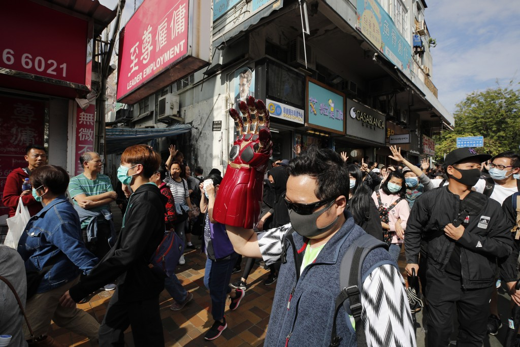"Protesters march during a demonstration against ""parallel traders"" who buy goods in Hong Kong to resell in mainland China in Sheung Shui near the Chin..."