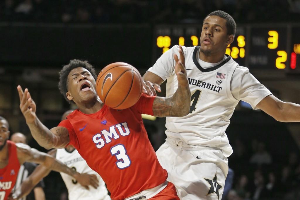 Vanderbilt guard Jordan Wright (4) blocks a shot by SMU guard Kendric Davis (3) during the second half of an NCAA college basketball game Saturday, Ja...