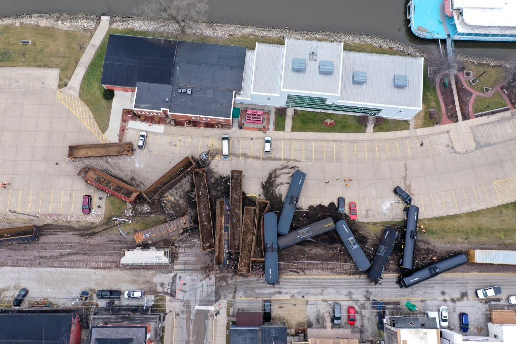 This aerial photo provided by the Scott County, Iowa, Emergency Management Agency shows a train derailment that sent at least a dozen rail cars and ta...