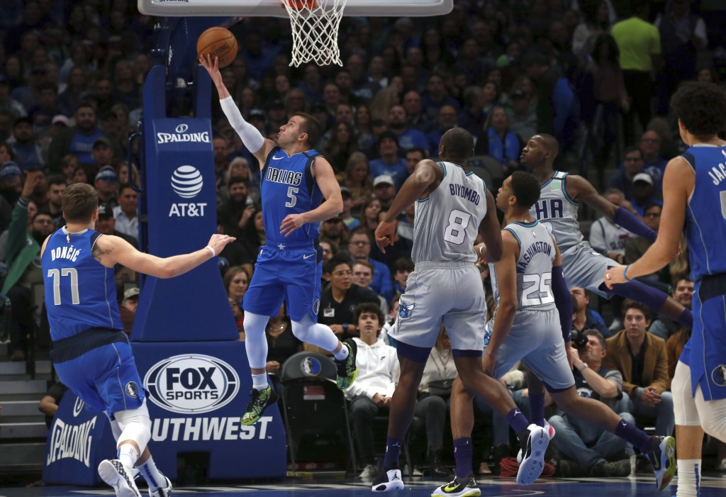Dallas Mavericks guard J.J. Barea (5) shoots against the Charlotte Hornets in the first half in an NBA basketball game Saturday, Jan. 4, 2020, in Dall...