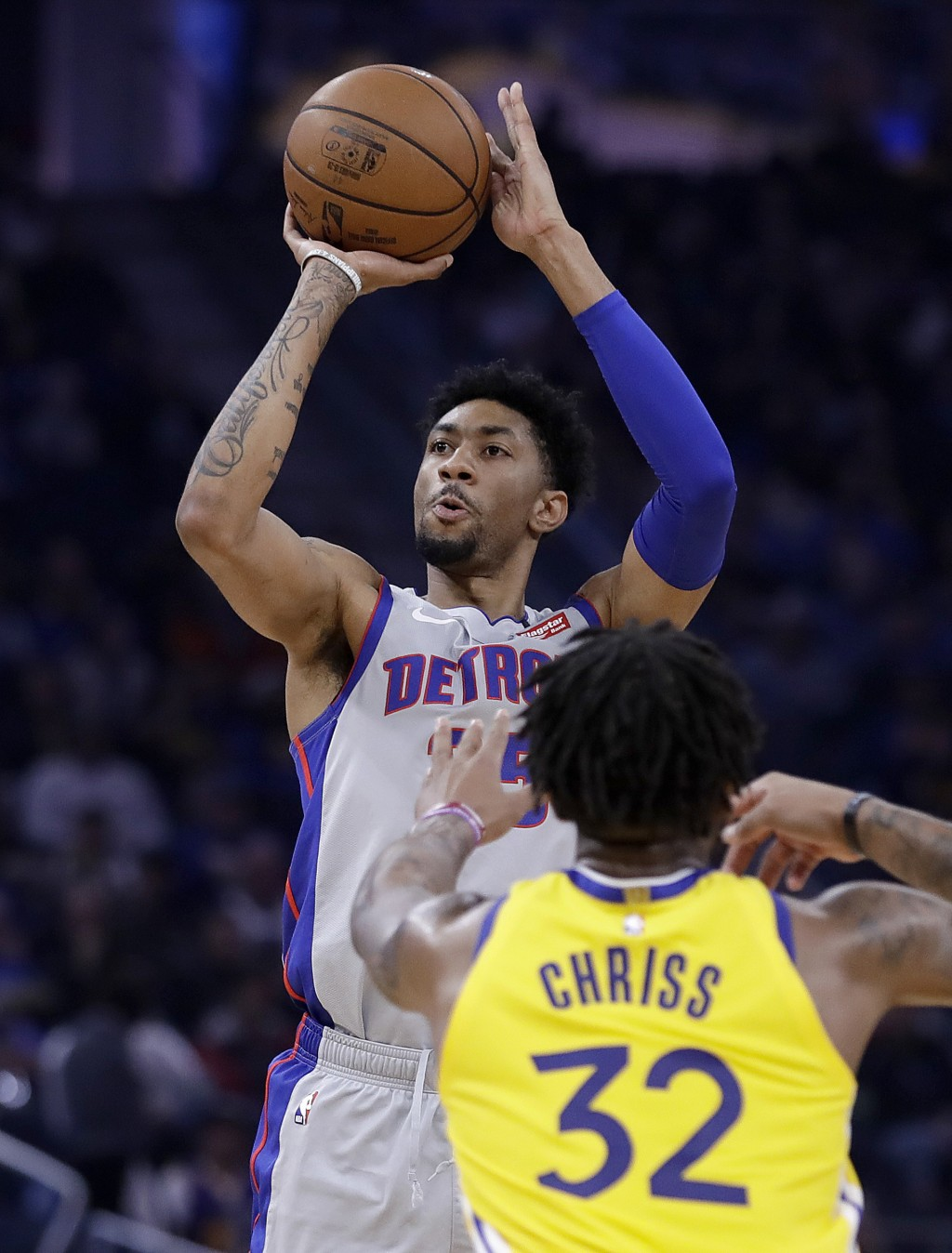 Detroit Pistons' Christian Wood, left, shoots over Golden State Warriors' Marquese Chriss (32) in the first half of an NBA basketball game Saturday, J...