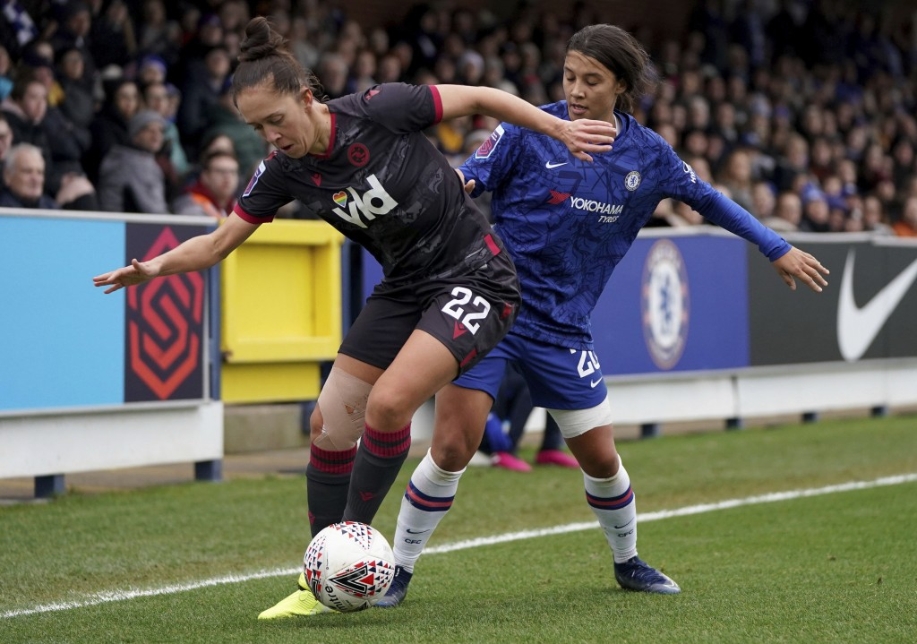 Chelsea's Samantha Kerr, right, and Reading's Jo Potter in action during their Women's Super League soccer match at The Cherry Red Records Stadium in ...