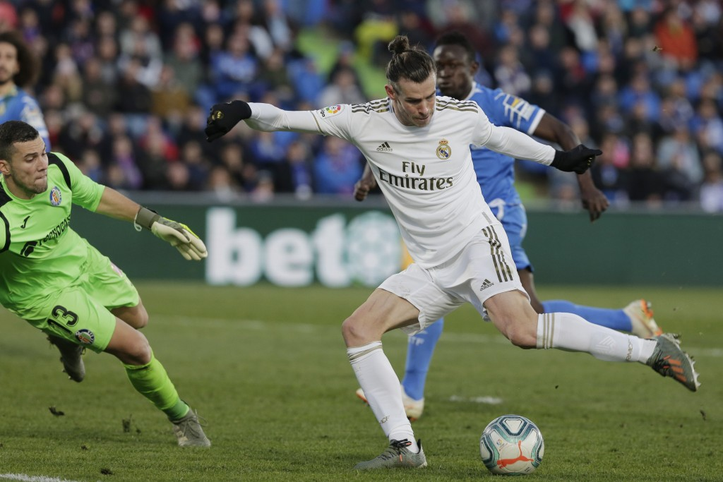 Real Madrid's Gareth Bale prepares to shoot during a Spanish La Liga soccer match between Getafe and Real Madrid at the Coliseum Alfonso Perez stadium...