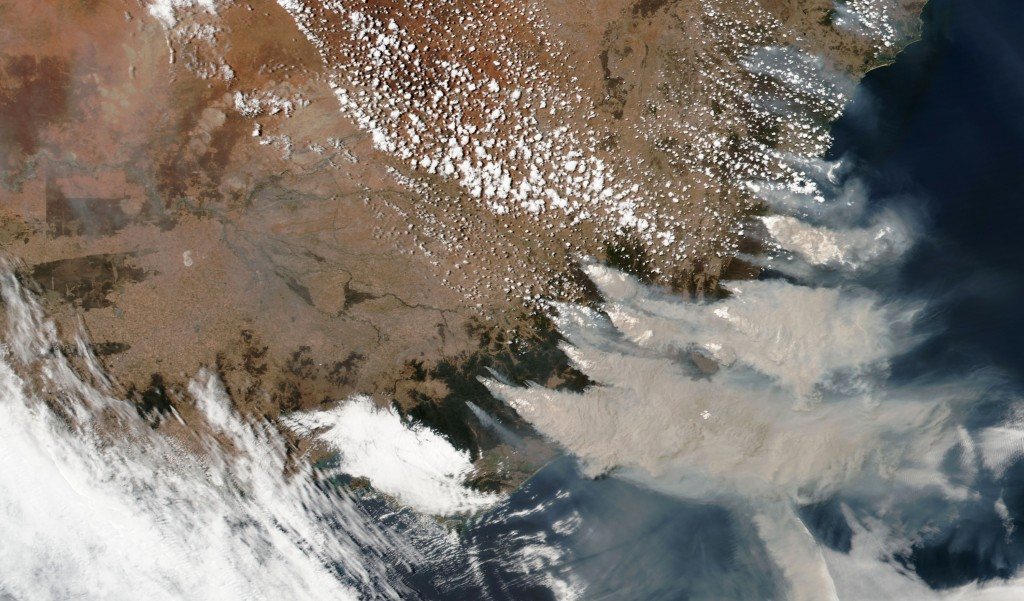 This satellite image provided by NASA on Saturday, Jan. 4, 2020 shows wildfires in Victoria and New South Wales, Australia.  Australia's prime ministe...