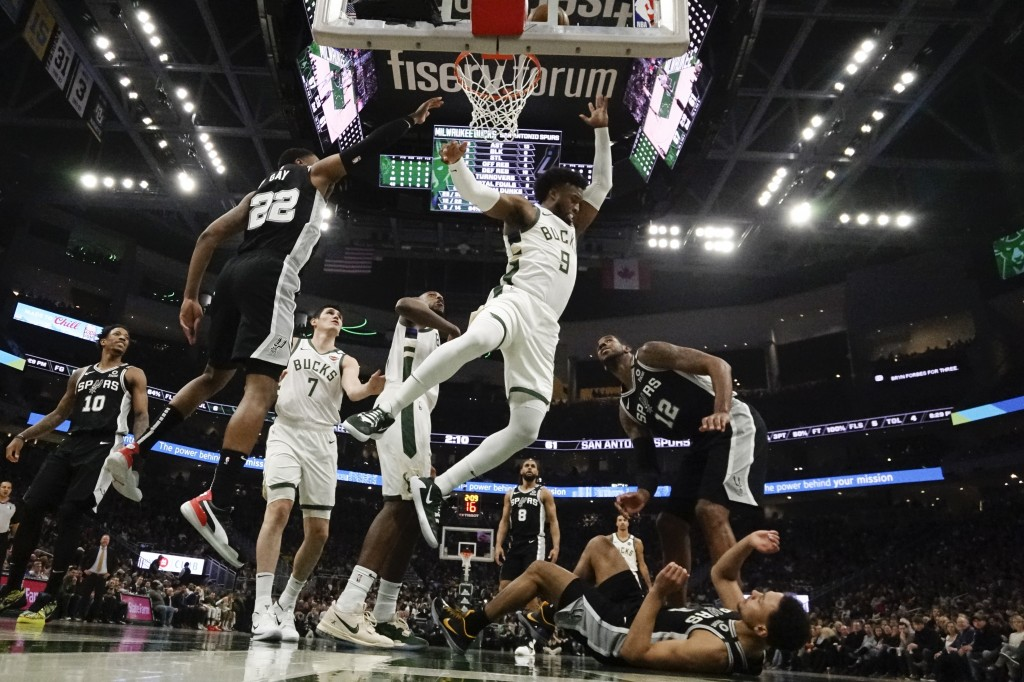 Milwaukee Bucks' Wesley Matthews shoots during the first half of an NBA basketball game against the San Antonio Spurs Saturday, Jan. 4, 2020, in Milwa...