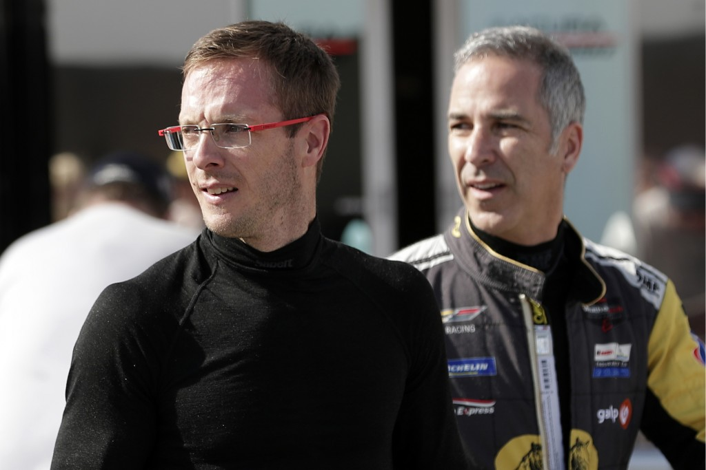 FILE - In this Friday, Jan. 3, 2020, file photo, Sebastien Bourdais, left, and Joao Barbosa walk back to their garage after a practice session during ...