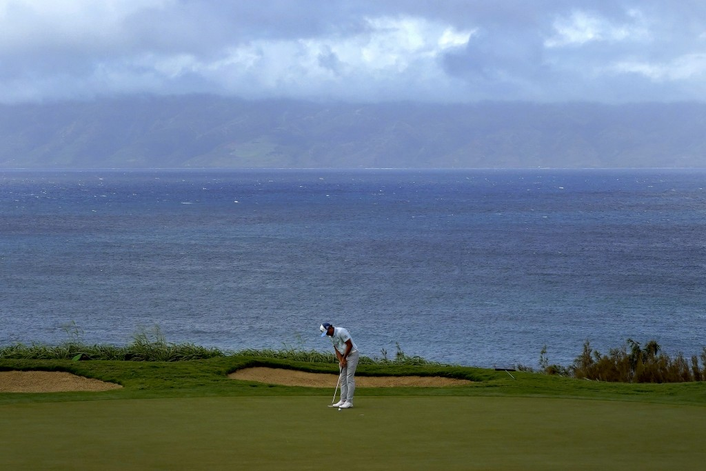 Rickie Fowler putts on the 12th green during third round of the Tournament of Champions golf event, Saturday, Jan. 4, 2020, at Kapalua Plantation Cour...