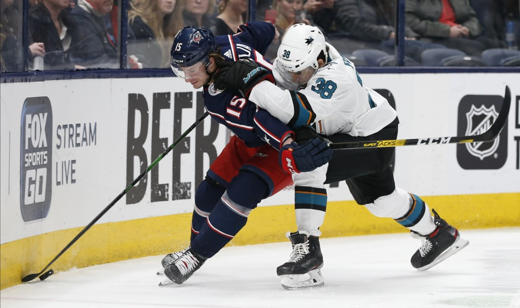 San Jose Sharks' Mario Ferraro, right, chases Columbus Blue Jackets' Jakob Lilja, of Sweden, behind the net during the second period of an NHL hockey ...