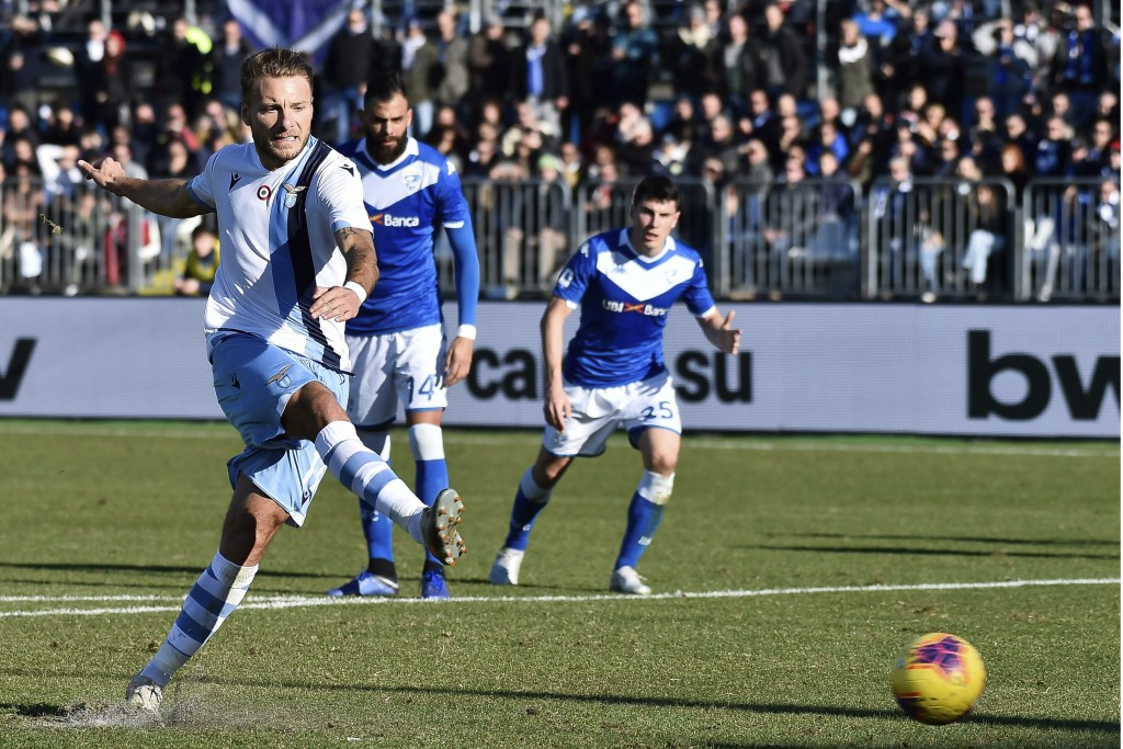 Lazio's Ciro Immobile scores his side's first goal on a penalty kick, during the Italian Series A soccer match between Brescia and Lazio at the Mario ...