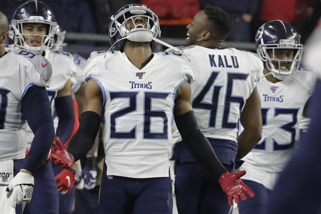 Tennessee Titans cornerback Logan Ryan celebrates his interception for a touchdown against the New England Patriots in the second half of an NFL wild-...