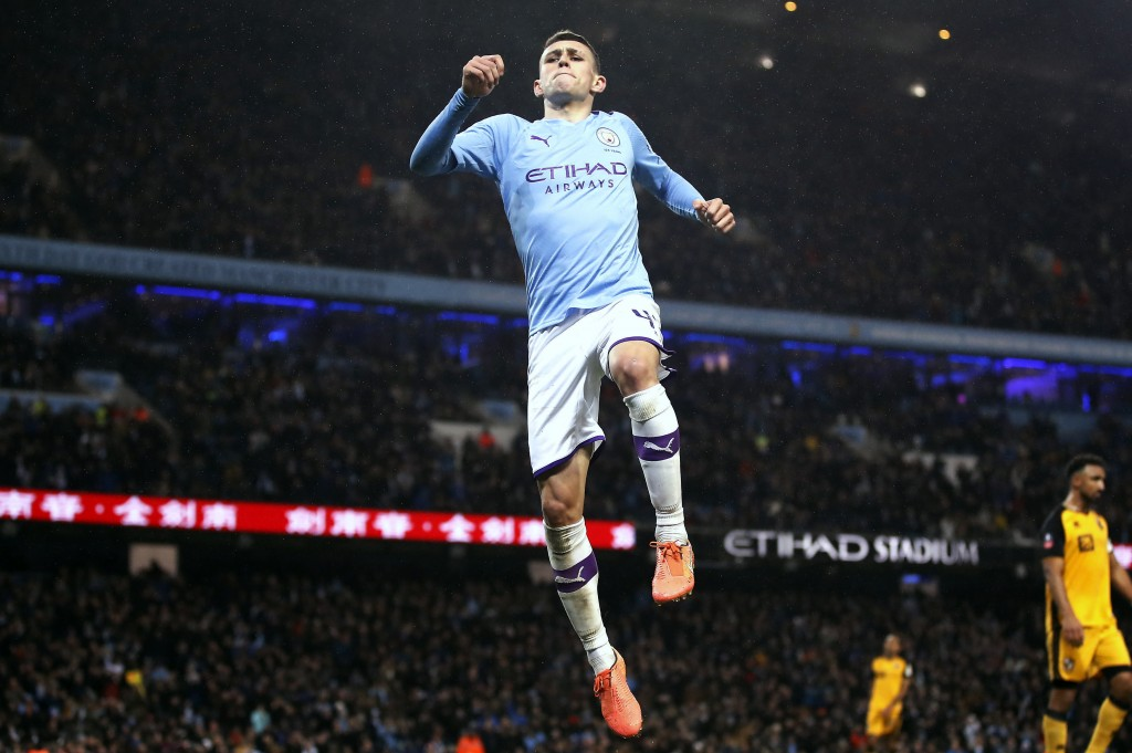 Manchester City's Phil Foden celebrates scoring his side's fourth goal of the game during the English FA Cup third round soccer match between Manchest...