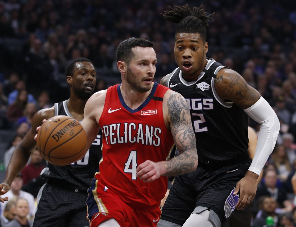 New Orleans Pelicans guard JJ Redick, left, drives against Sacramento Kings forward Richaun Holmes during the first quarter of an NBA basketball game ...