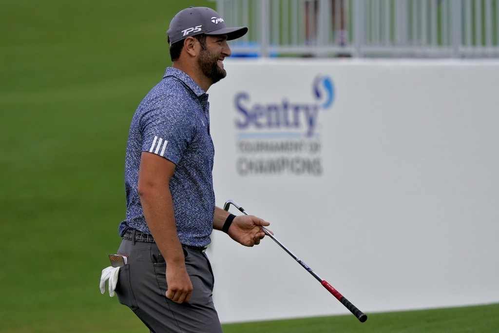 Jon Rahm smiles after chipping in for eagle on the ninth green during third round of the Tournament of Champions golf event, Saturday, Jan. 4, 2020, a...