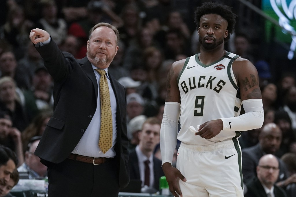 Milwaukee Bucks head coach Mike Budenholzer talks to Wesley Matthews during the first half of an NBA basketball game against the San Antonio Spurs Sat...