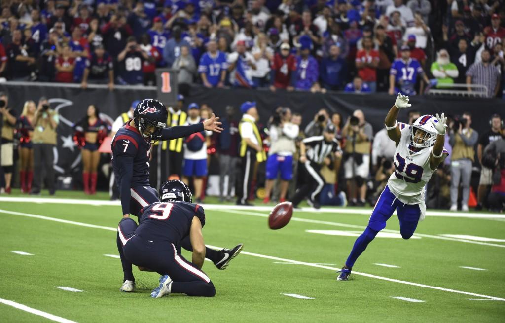 Houston Texans kicker Ka'imi Fairbairn (7) kicks a game-winning 28-yard field goal as Buffalo Bills cornerback Kevin Johnson (29) tries to block the k...