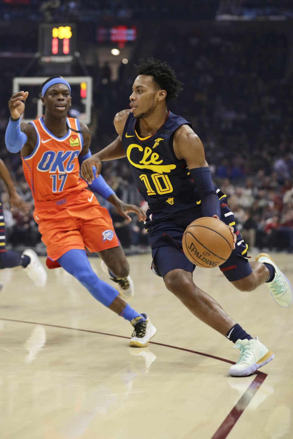 Cleveland Cavaliers' Darius Garland (10) drives past Oklahoma City Thunder's Dennis Schroder (17) in the first half of an NBA basketball game, Saturda...