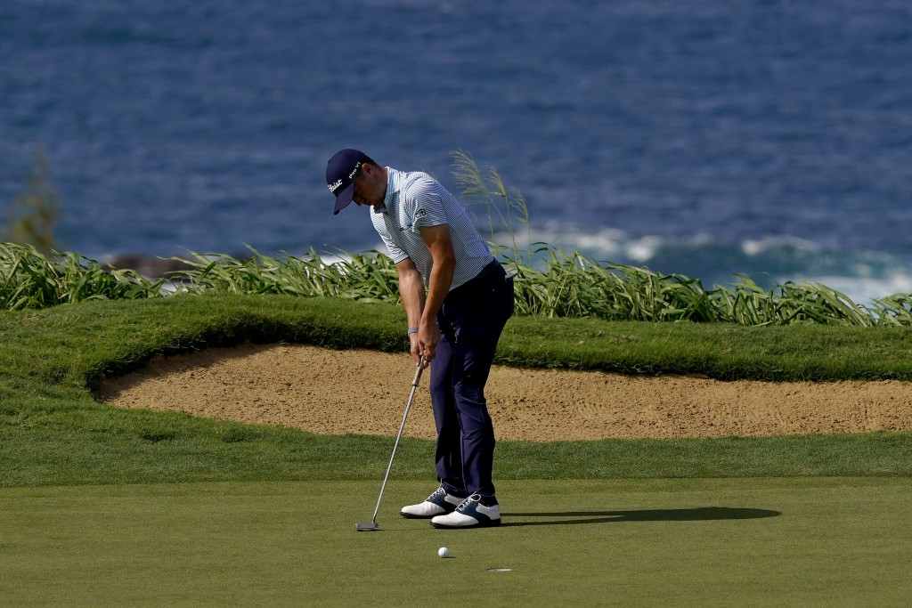 Justin Thomas putts on the 12th green during third round of the Tournament of Champions golf event, Saturday, Jan. 4, 2020, at Kapalua Plantation Cour...