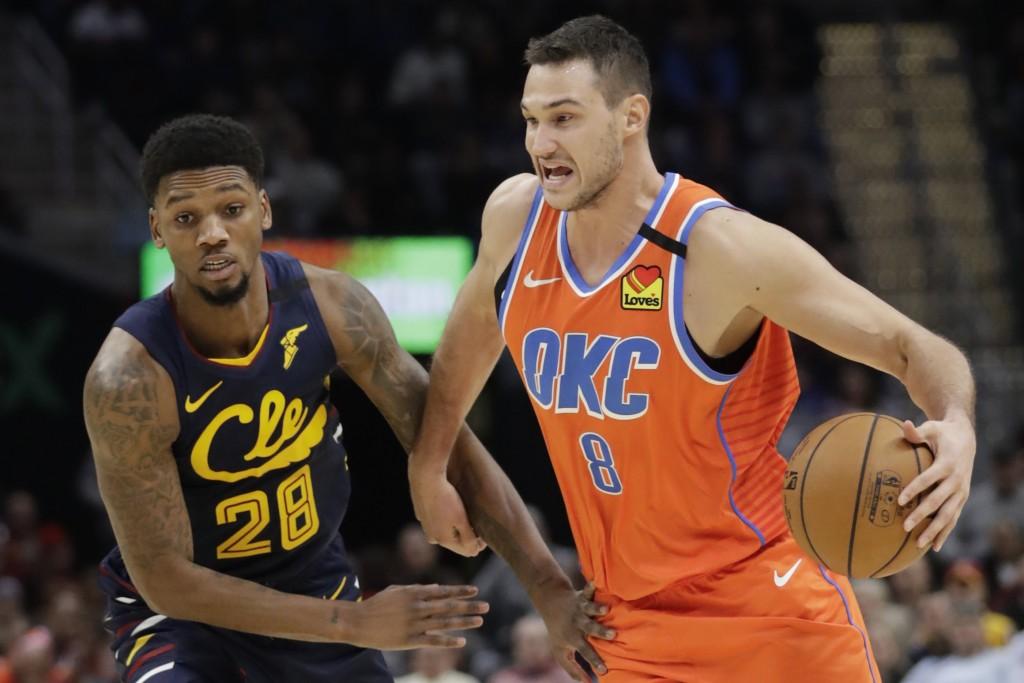 Oklahoma City Thunder's Danilo Gallinari (8) drives past Cleveland Cavaliers' Alfonzo McKinnie (28) in the second half of an NBA basketball game, Satu...