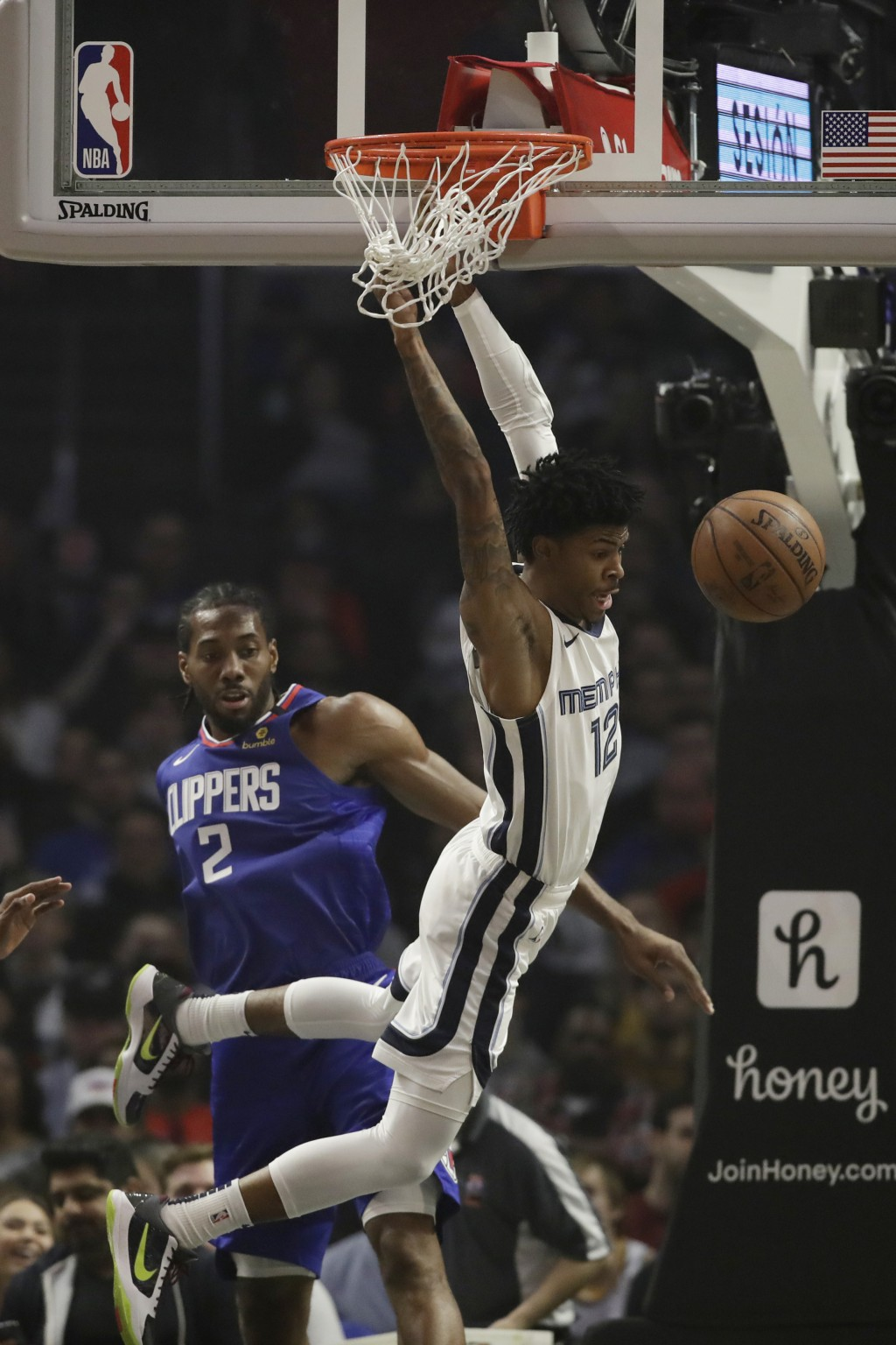 Memphis Grizzlies' Ja Morant (12) misses on a dunk attempt as Los Angeles Clippers' Kawhi Leonard (2) defends during the first half of an NBA basketba...
