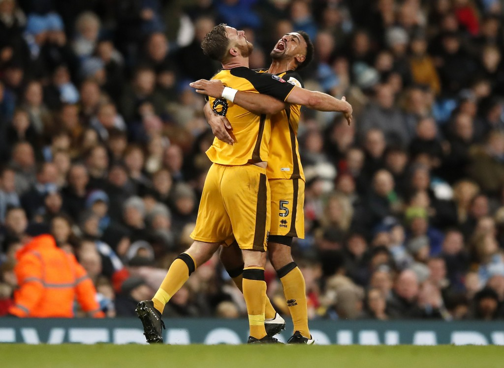 Port Vale's Tom Pope, left, celebrates scoring his side's first goal of the game with teammate Leon Legge during the English FA Cup third round soccer...