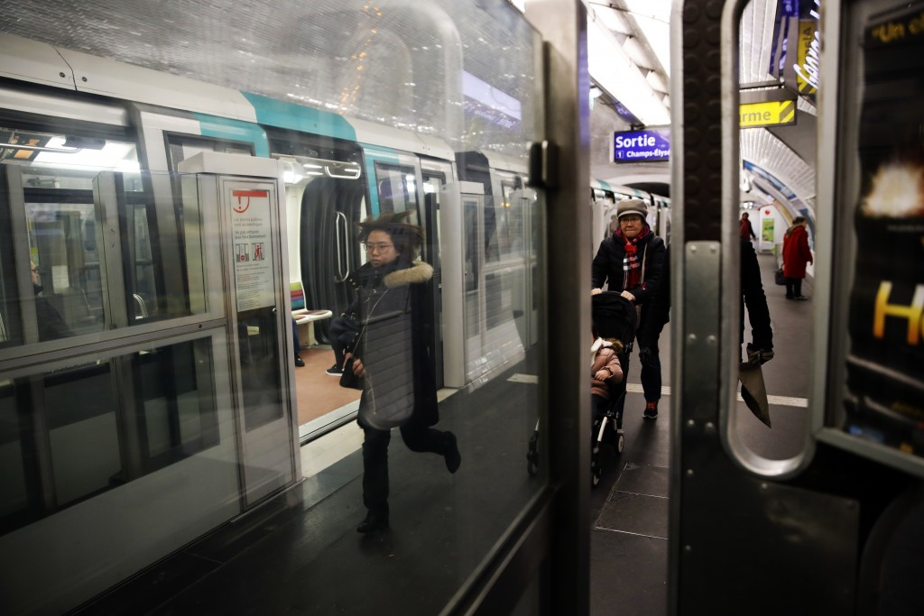 CORRECTING OBJECT NAME TO FRANCE STRIKES - Commuters exit the Paris subway during the 32th day of transport strikes, Sunday, Jan. 5, 2020. With more t...