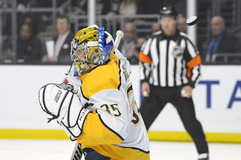 Nashville Predators goaltender Pekka Rinne deflects a shot during the second period of the team's NHL hockey game against the Los Angeles Kings on Sat...