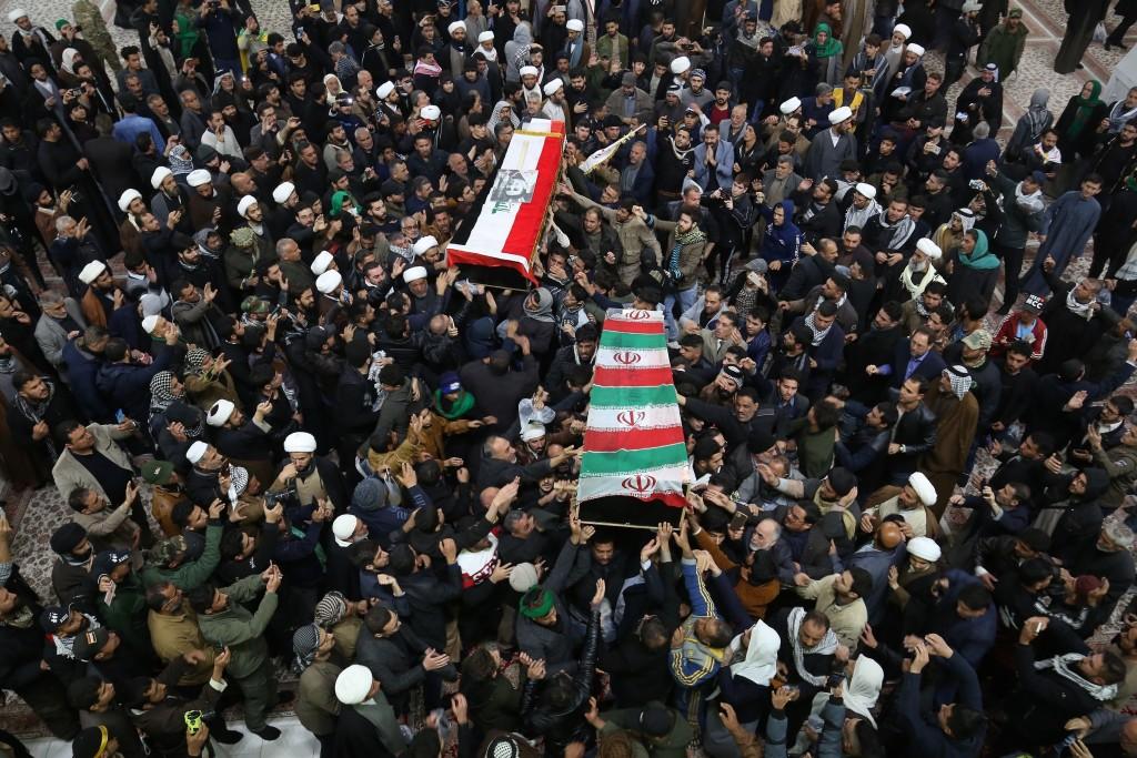 Mourners carry the coffins of Iran's Gen. Qassem Soleimani and Abu Mahdi al-Muhandis, deputy commander of Iran-backed militias at the Imam Ali shrine ...