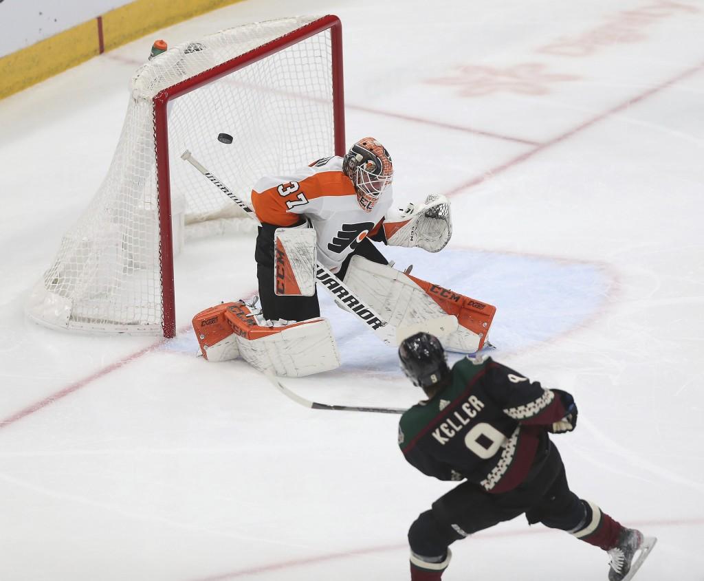 Arizona Coyotes' Clayton Keller's (9) shot bounces off the crossbar behind Philadelphia Flyers goalie Brian Elliott (37) during the second period of a...