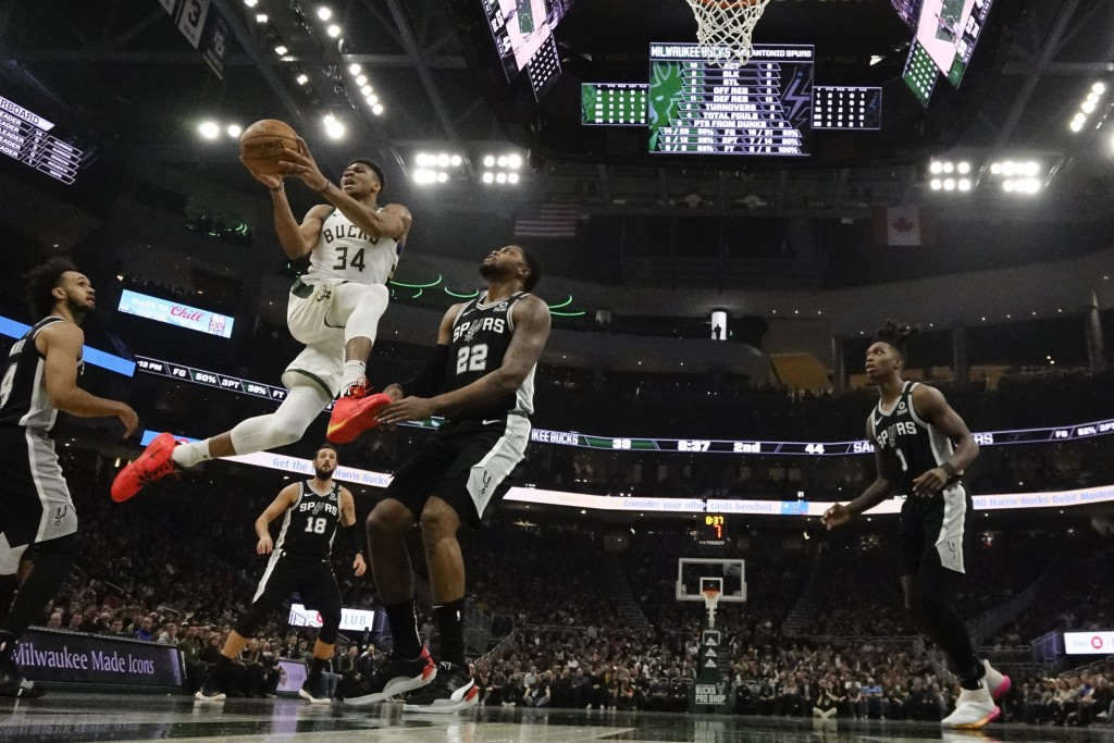 Milwaukee Bucks' Giannis Antetokounmpo drives during the first half of an NBA basketball game against the San Antonio Spurs Saturday, Jan. 4, 2020, in...
